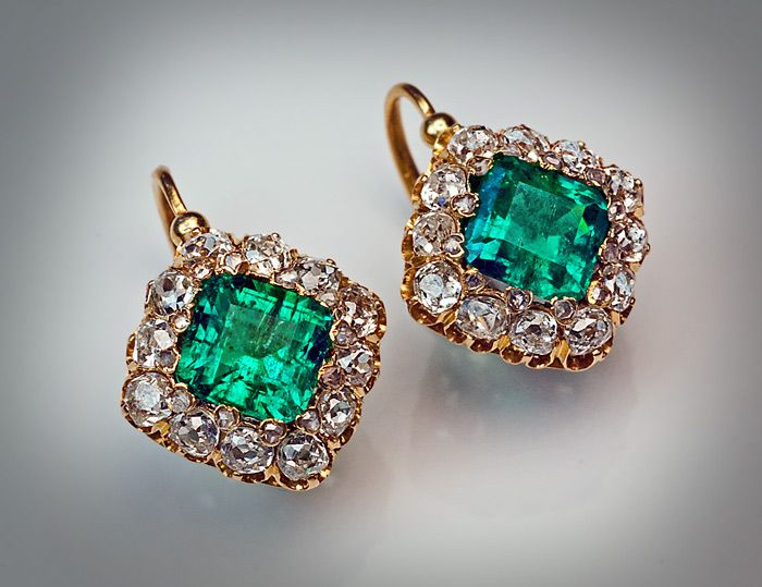 Antique Emerald and Diamond Cluster Earrings French, circa 1890 A pair of 18K gold earrings is set with two emeralds of excellent color and strong saturati