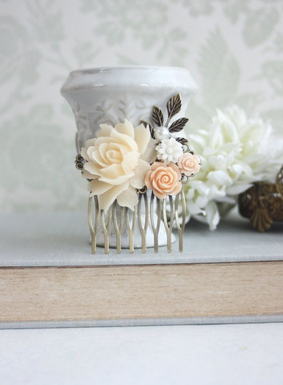 ♥´¨) ¸.•´ ¸.•*´¨) (¸.•´ ♥ ~ Gorgeous shades of peach flower comb made with a large Ivory rose, with smaller peach flowers, a white flower, faux pearl, and a brass leaf. Each cabochon has been securely attached onto a sturdy, and beautiful quality antiqued brass filigree comb. A beautiful hair piece for your special day, and bridesmaids.  It would make a wonderful gift for a peach wedding, or for everyday wear :)  * Last photo shows a model wearing another comb for size reference. This comb…