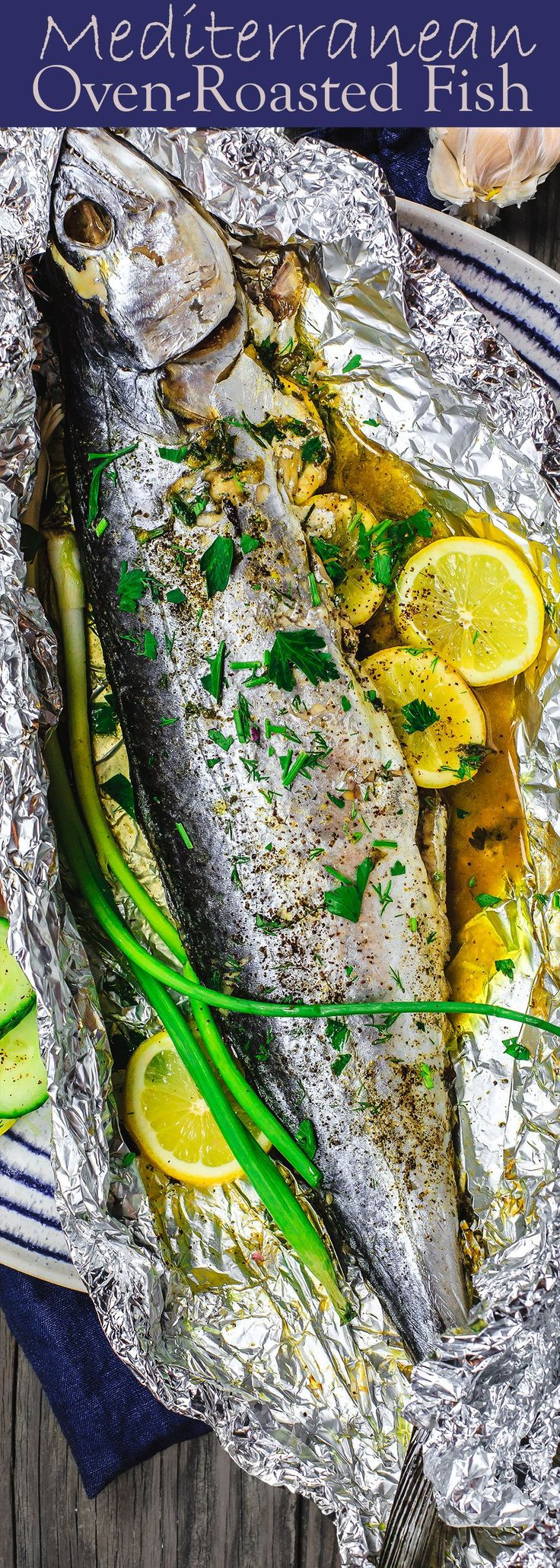 Mediterranean Oven Baked Spanish Mackerel Recipe | The Mediterranean Dish. Easy Greek inspired fish recipe. Whole fish stuffed with garlic, herbs, and lemon slices and oven baked in a foil packet with olive oil. A delicious Mediterranean diet recipe. See it on TheMediterraneanDish.com