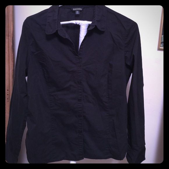 Black button down shirt Black button down shirt. 62% cotton, 35% polyester, 3% spandex George Tops Button Down Shirts