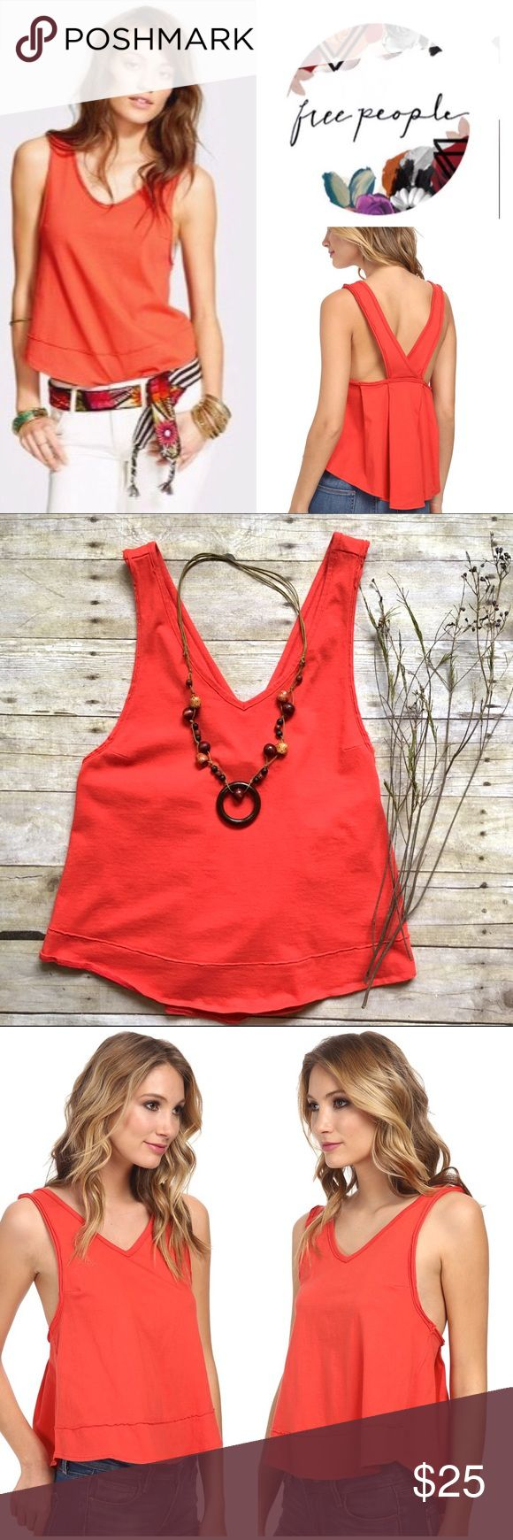 "Free People orange Toying Around tank Superbly soft cotton tank features a relaxed fit and deep straps at V-back. V-neckline and sleeveless construction. Pull-on design. Raw-cut trim. Curved hemline. 100% cotton. 24""L. In excellent condition. As seen on Melissa Benoit in the movie The Longest Ride. Size Medium. Free People Tops Tank Tops"