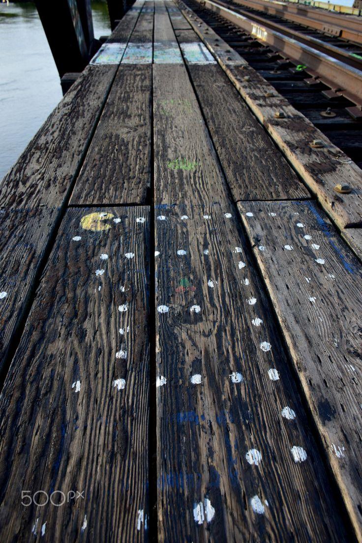 Pacman - Pac Man game graffiti painted on abandoned railroad bridge.
