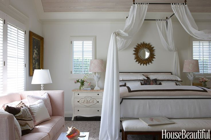 "The master bedroom in this Palm Beach home received a pink-and-white makeover by designer Gary McBournie. ""It started with the fabric on the lampshade — a simple, soft shell pink and white linen print,"" he explains.   - HouseBeautiful.com"