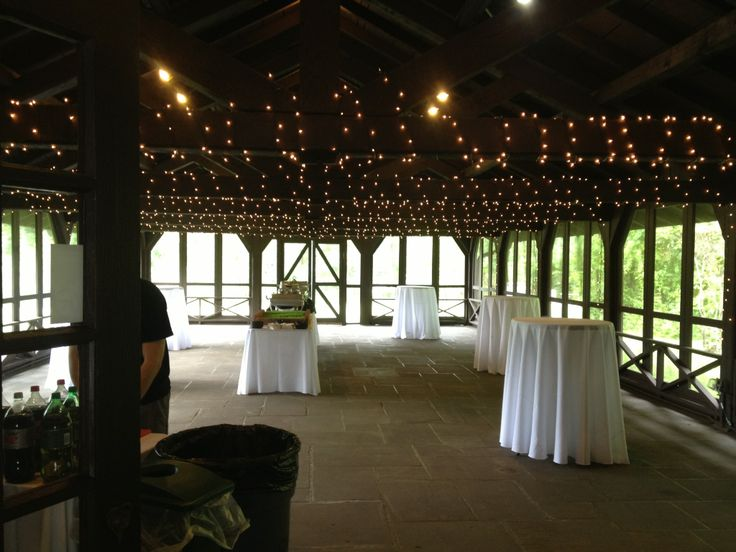 Using twinkle lights on the beams in the screen porch at happy days lodge add such