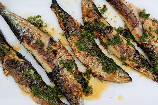 Grilled sardines cooked on the BBQ, served whole with a chipotle sauce. Cook fish on the BBQ - easy and cheap BBQ recipes!