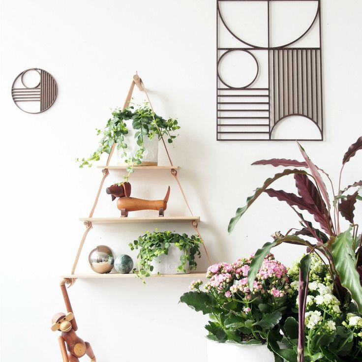 Limited space doesn't mean limited style and today I'm sharing a small vignette from my living room you know there's nothing like a well-curated display of indoor plants. It's impressive on two levels, the artistic and the practical.