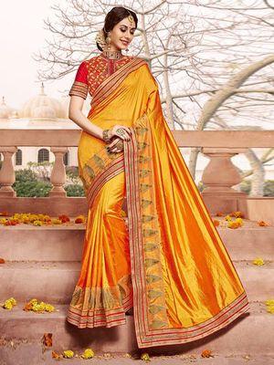 Yellow plain silk saree with blouse