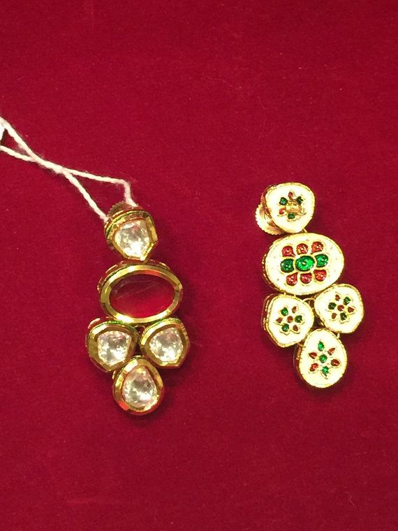Kundan earrings with Red semi precious stone and full mina design on the back.