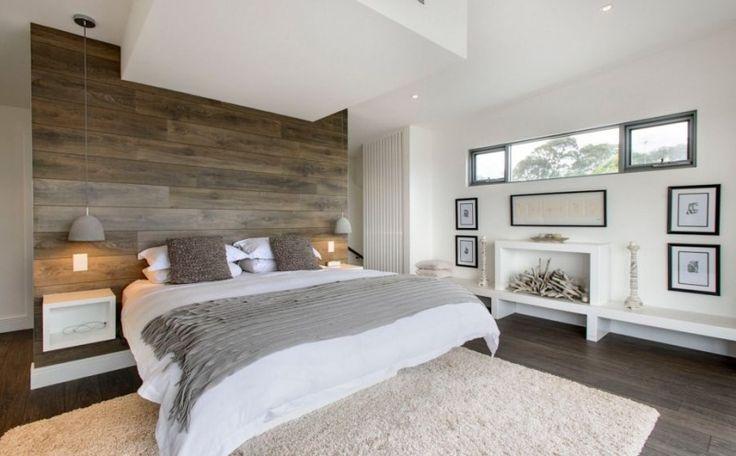 chambre taupe aux accents blancs et lambris mural en bois massif