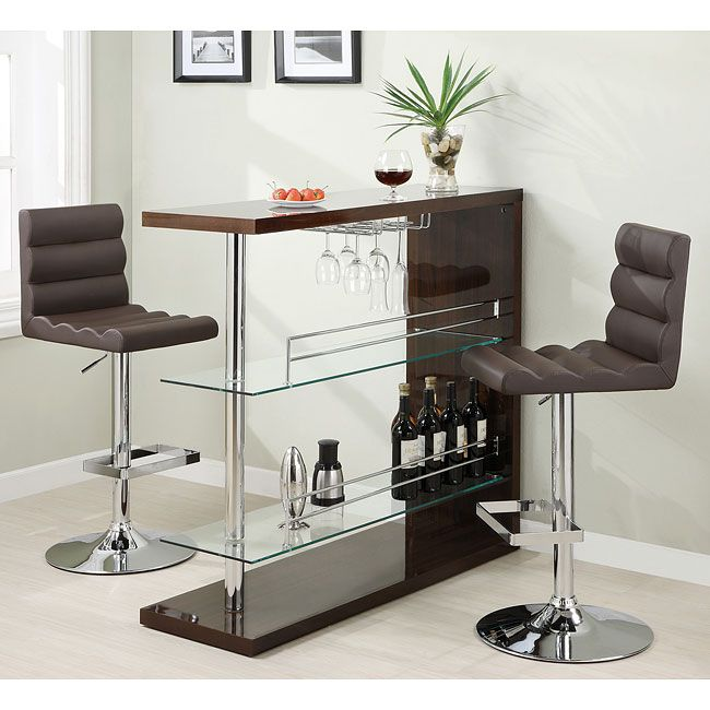 Be the envy of all your friends with this Sleek Contemporary Bar Set (Cappuccino). Equipped with 2 glass storage shelves and a wine glass holder, it has all the storage you need to mix a drink of any kind. Complete the bar by setting matching chairs on each side and you're ready to play bartender, or have someone else mix you a drink!