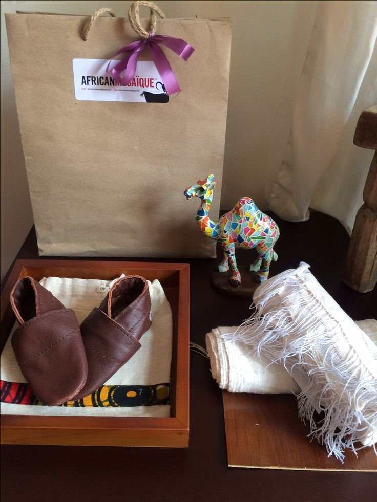 #instore handwoven blankets and leather slippers #handcraftedinethiopia #newborn #africanmosaique