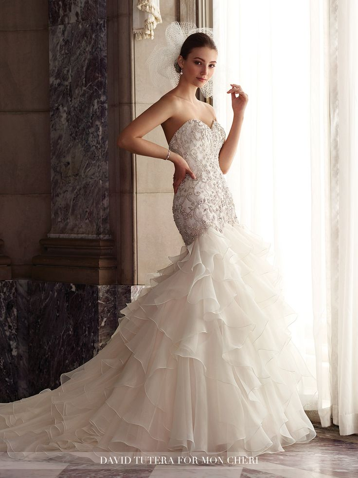 mon cheri bridals 117277 Dior - Strapless organza trumpet gown with sweetheart neckline, hand-pattern beaded embroidered motif bodice with dropped waist and V-back, full dramatic ruffled and tiered organza skirt spills into chapel length train, detachable spaghetti and halter straps included.