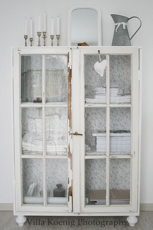 White cabinet. Inside = floral background