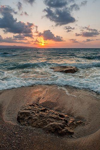 Sunset on a beach in Crete, Greece