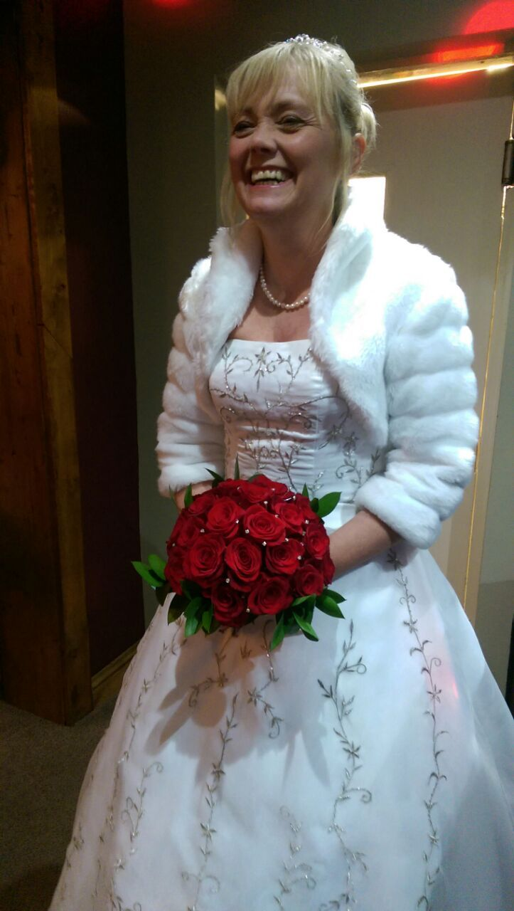 Classic winter wedding-Naomi roses with pearl accents and ruscus collar.
