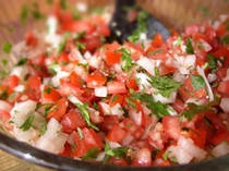 Basic Salsa! 2 cups seeded, chopped tomatoes (6-7 medium tomatoes) the leaves from one bunch of fresh cilantro, chopped* 6 cloves fresh chopped garlic 1/2 an onion chopped 1 jalapeno, finely chopped 1/2 teaspoon salt about 1 tablespoon lime juice Preparation: Mix all ingredients until well incorporated. Refrigerate overnight for maximum flavor.