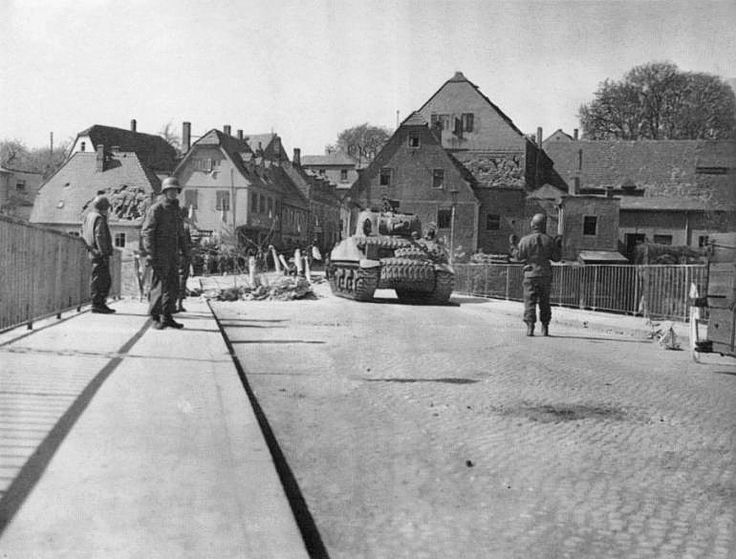 US troops on the Colditz Castle bridge, Sachsen, Germany, 16 Apr 1945. (US Army photo)