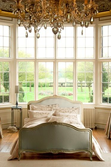 I want a big chandelier in the bedroom! And lots of windows (not this many :))! Love the small intimate bed! Leads to more snugging :)