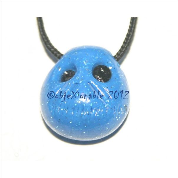 Blue Glitter Shrunken Skull Pendant