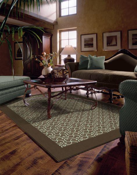 Blue And Brown Area Rug On Hardwood Floors