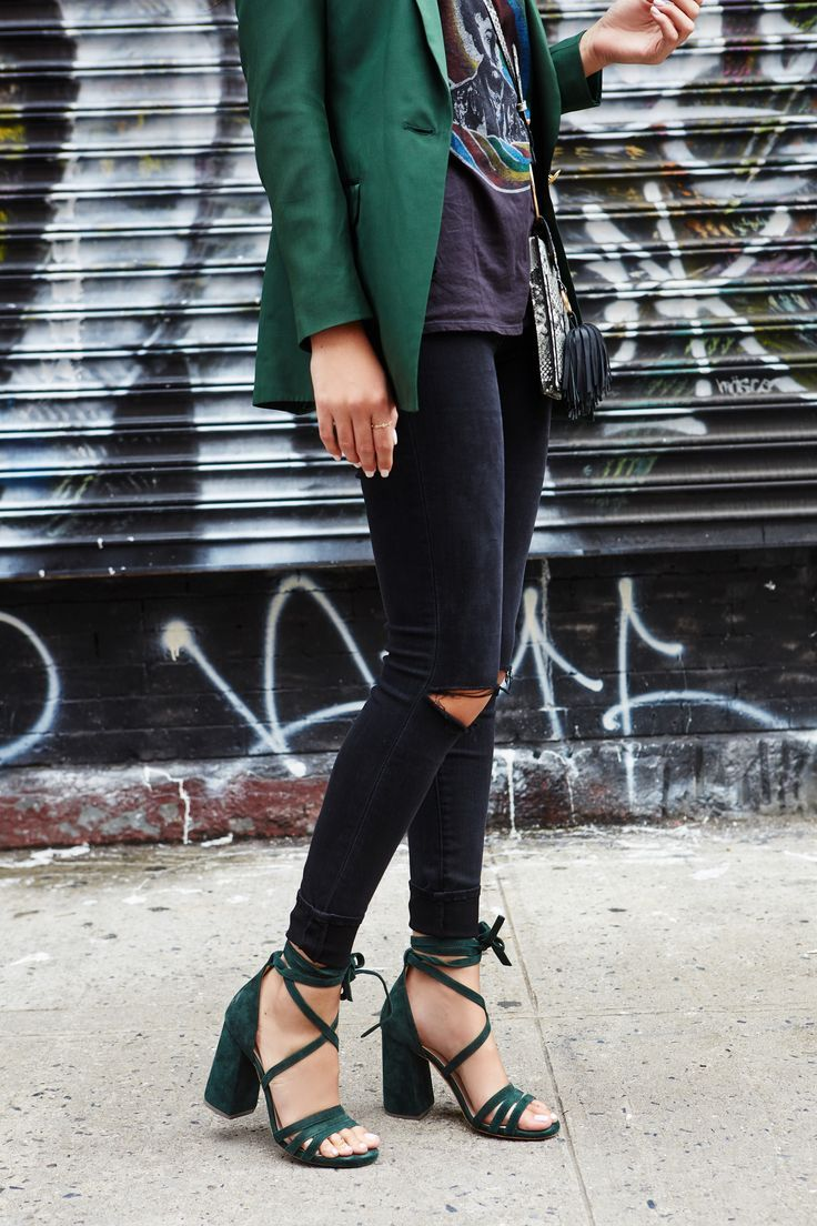 Rate Green Suede Lace Up Sandals from Revolve styled with black ripped jeans and a green suit jacket during NYFW by Julia Friedman.