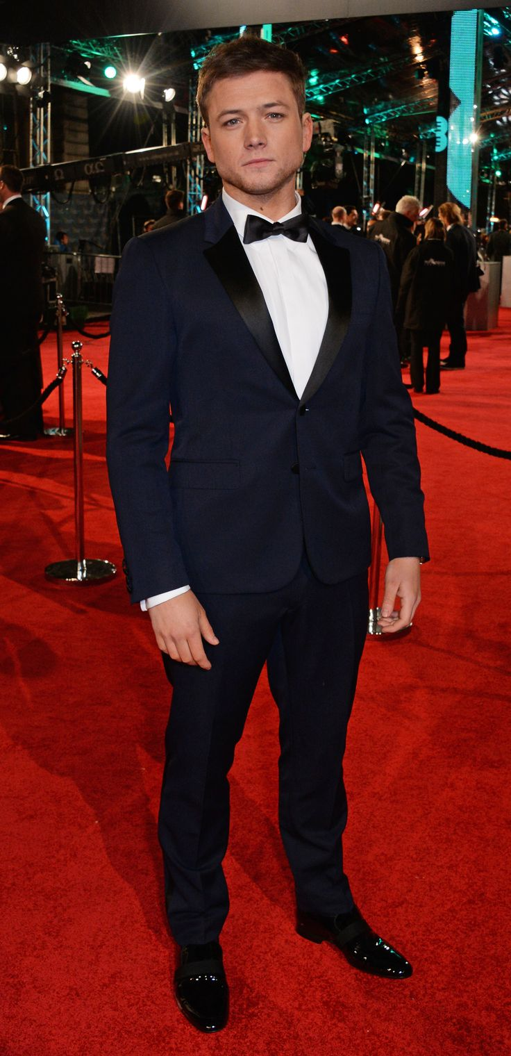 EEBAFTAs Rising Star nominee Taron Egerton on the red carpet at tonight's ceremony in a navy Burberry tuxedo