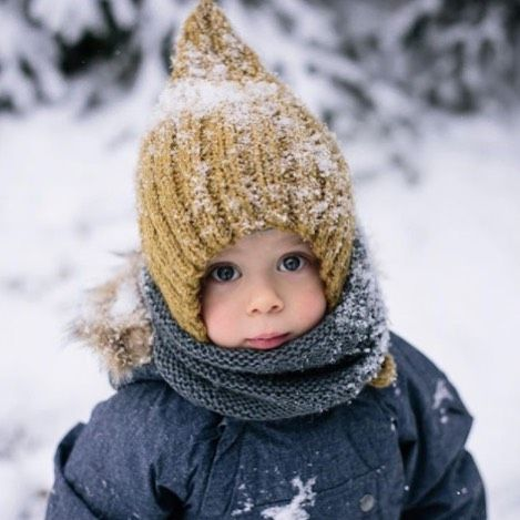 Wrap up warm! Toddler wearing yellow wooly hat in the snow @veronikagphotography #Netmumsloves