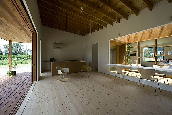 Open floorplan, white, light wood, opens to the outside with sliding doors Japanese Modern House Design