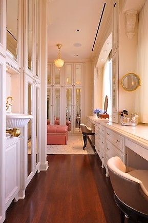 Stunning, luxurious walk-in closet design.