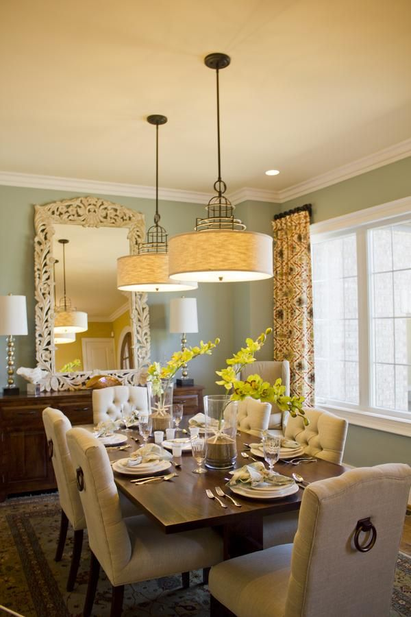 Cool idea for a large decorative mirror in a dining room for Casual dining lighting
