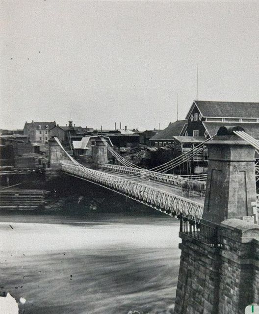 Suspension Bridge 1870 over the Ottawa River at the Chaudiere Falls connectiong Booth St. to Eddy St. in Hull designed by Samuel Keefer Located at the Chaudiere Falls, other bridges have followed this one but none as attractive
