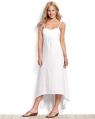Stay light on your feet and cool in the summer heat with this beautiful maxi dress. Made from luxurious, breathable linen, it has floral embroidery at the bust that's complemented by gathered fabric at the empire waist. A high-low hem adds an elegant touch, while shoulder straps let you personalize the fit. Perfect for sitting on the deck of a bungalow at sunset sipping sangria with friends. 100% linen. Machine wash or dry clean. 37.5in. center front length; 46.5in. center back length. ...