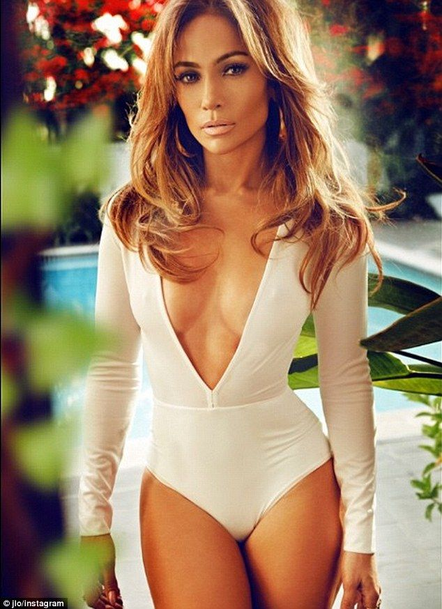Va va voom: Jennifer Lopez, 45, puts her cleavage on display in a plunging number for a Co...