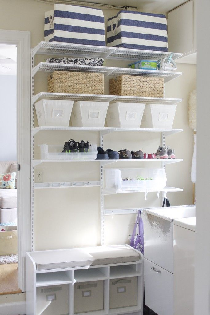 Make the most of your laundry room by adding a mudroom / utility wall! So easy! And designed by a professional organizer!