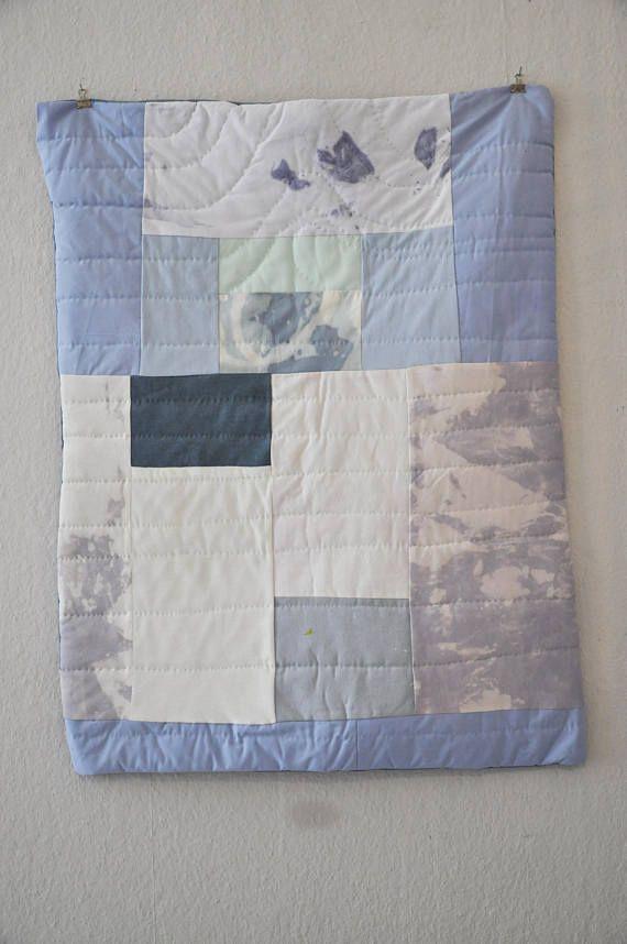 Manta de bebé en azul y blanco