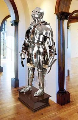 Gothic Suit of Armor for sale stands approximately 6 ½ feet tall. The fully articulated Italian Gothic Suit of Armor is a full suit of armor designed upon medieval Italian style. This beautiful armor is constructed of 18 gauge, hand forged steel and crafted by master blacksmiths. This knightly suit of medieval armor is shipped partially assembled with a gorgeous hardwood display pedestal. Italian Gothic Suit of Armor includes a full size skeletal body and decorative skirt.