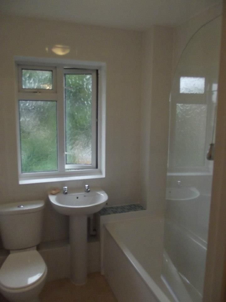 This was completed cost effectively with a simple white suite and tiles.
