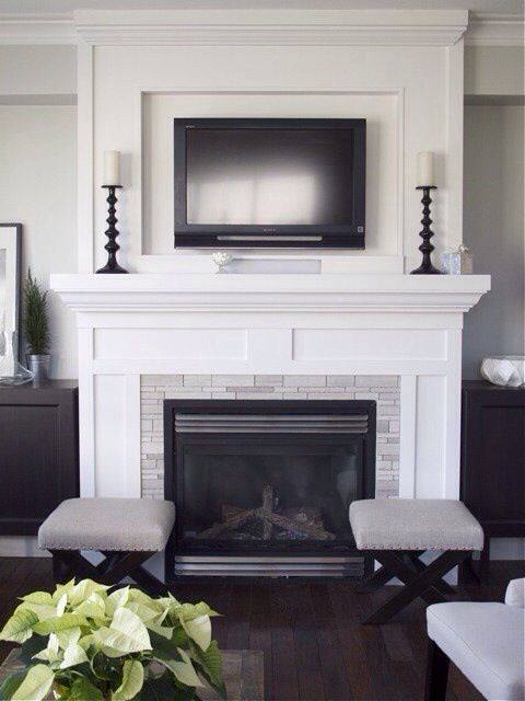 Shaker style surround could be done in white or stained for Tv over fireplace