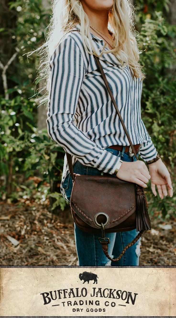 This soft, tumbled brown leather crossbody bag is the perfect medium size, with small handmade details and a large interior with pockets for everything you need. Vintage finish and braided details achieve a classic look with a nod to that boho style. Adjustable strap for the most comfortable cross body fit, in any outfit, for travel, work, or play. #style #leather