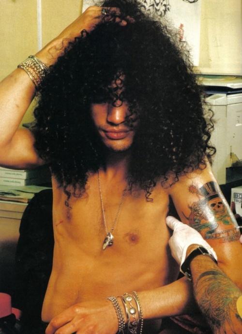 Slash getting tatted...Knew Slash thru his Mom, the lovely Ola Hudson...Slash LOVED SNAKES.