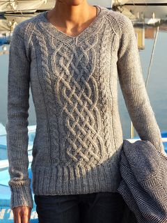 This cabled raglan is worked in the round from the bottom up.