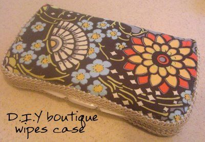 D.I.Y. boutique wipes case tutorial - no sewing, need hot glue, mod podge, scrap fabric, trim, and batting. And of course a travel wipes case.