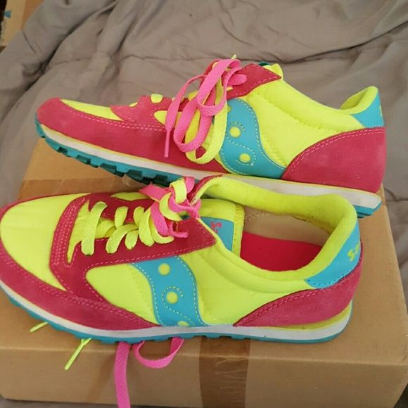 Saucony sneakers super cute size 9 Saucony sneakers size 9 super cute hot pink blue neon yellow with hot pink and neon yellow shoe laces worn once in mint condition Saucony Shoes Sneakers