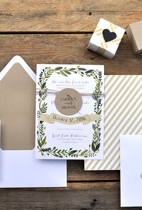 A green and white wedding invitation for winter by @smittenonpaper | Brides.com