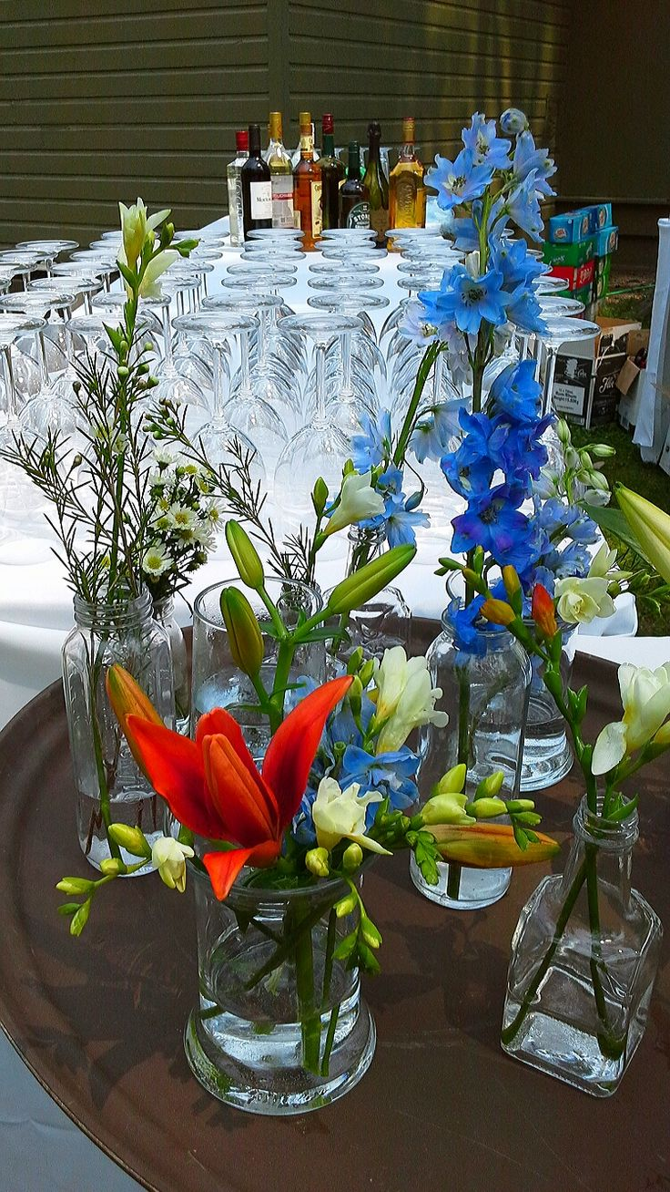 assorted vases with delphinium, lilies and freesia; design by Davis Floral Creations