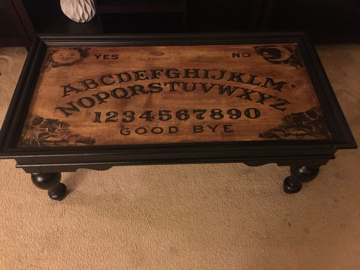 Ouija board coffee table.. Laser printed on paper and transferred to wood using gel medium, water, and sore fingers..! Came out awesome!