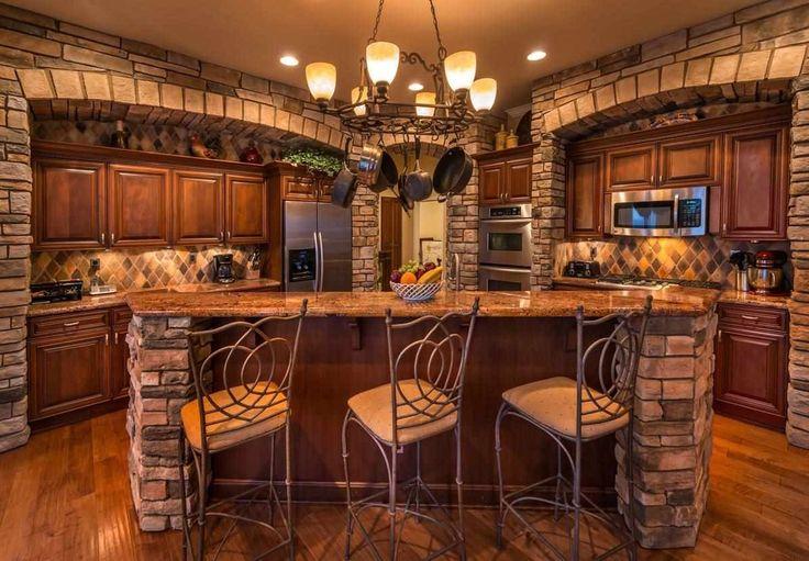 Mediterranean Kitchen with Limestone Tile, Complex granite counters, Kitchen island, Raised panel, L-shaped, Hardwood floors