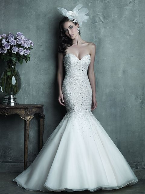 The beading on this strapless English net and organza mermaid gown is perfect, covering the sweetheart bodice and gradually sprinkling the skirt with tiny sparkling gems.
