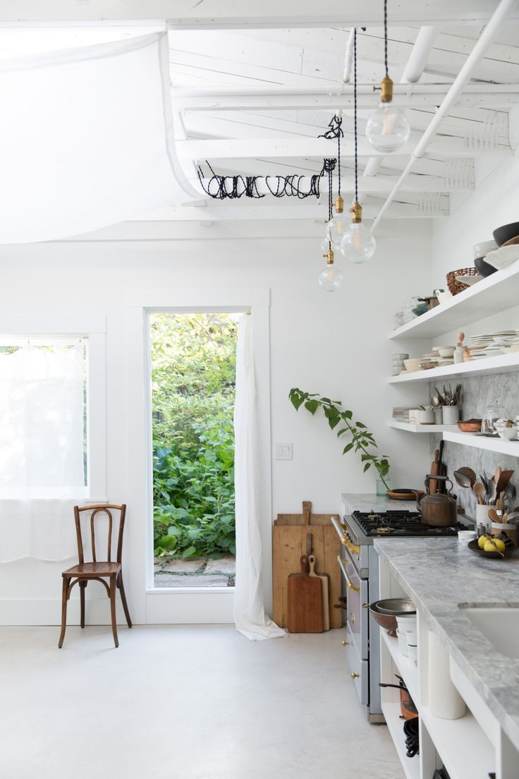 Adding to the space's endlessly changeable spirit:Apartment Pendant lights from Electric Schoolhouse slung around the rafters. (The team attached outlets to the ceiling beams for flexible plugging-in.)