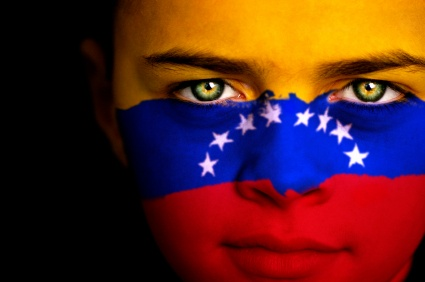 Another breathtaking photo! This is a little boy with the Venezuelan flag painted on his face.